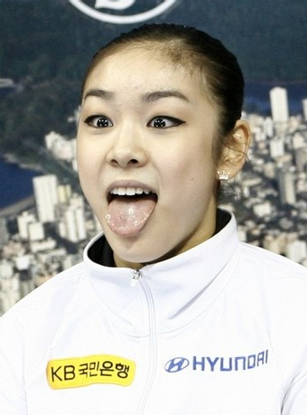 Kim Yu-na of South Korea reacts after the Women's Free Skate at the ISU Four Continents Figure Skating Championships in Vancouver